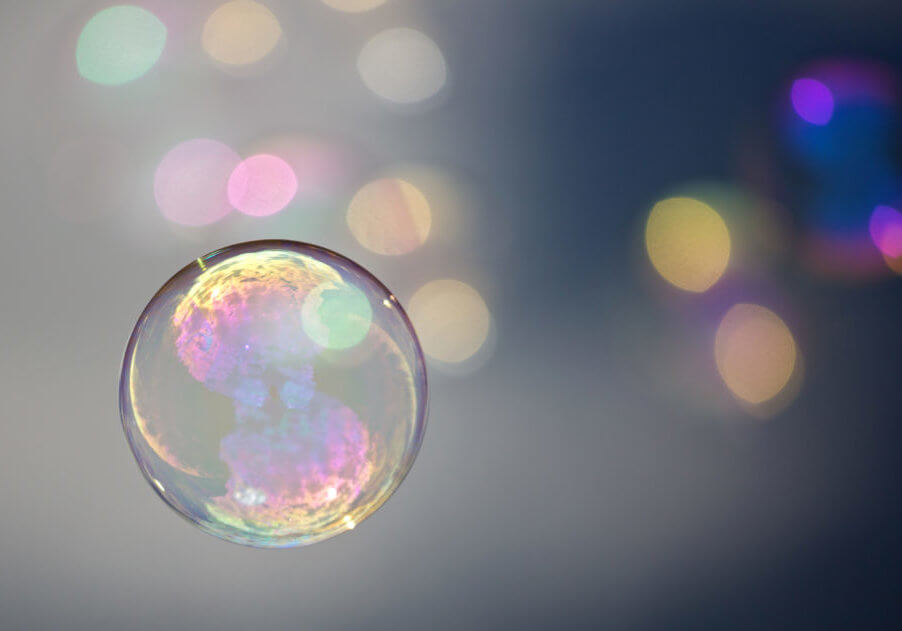 one in the foreground floating bubble with unschafen colorful bubbles in the background